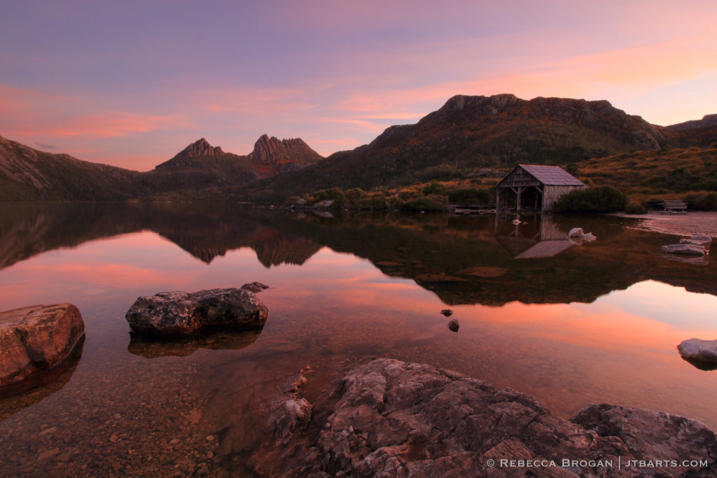 Cradle Mountain Dove Lake Sunset Reflection with boathouse, boat shed. Cradle Mountain - Lake St. Clair National Park, Tasmania.